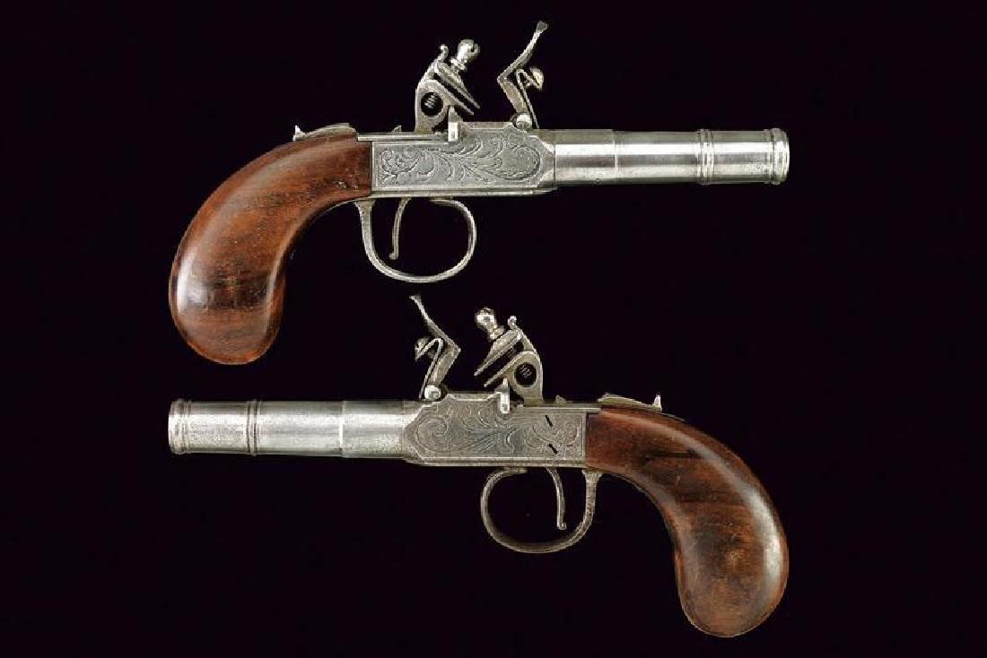 A pair of flintlock pocket pistols