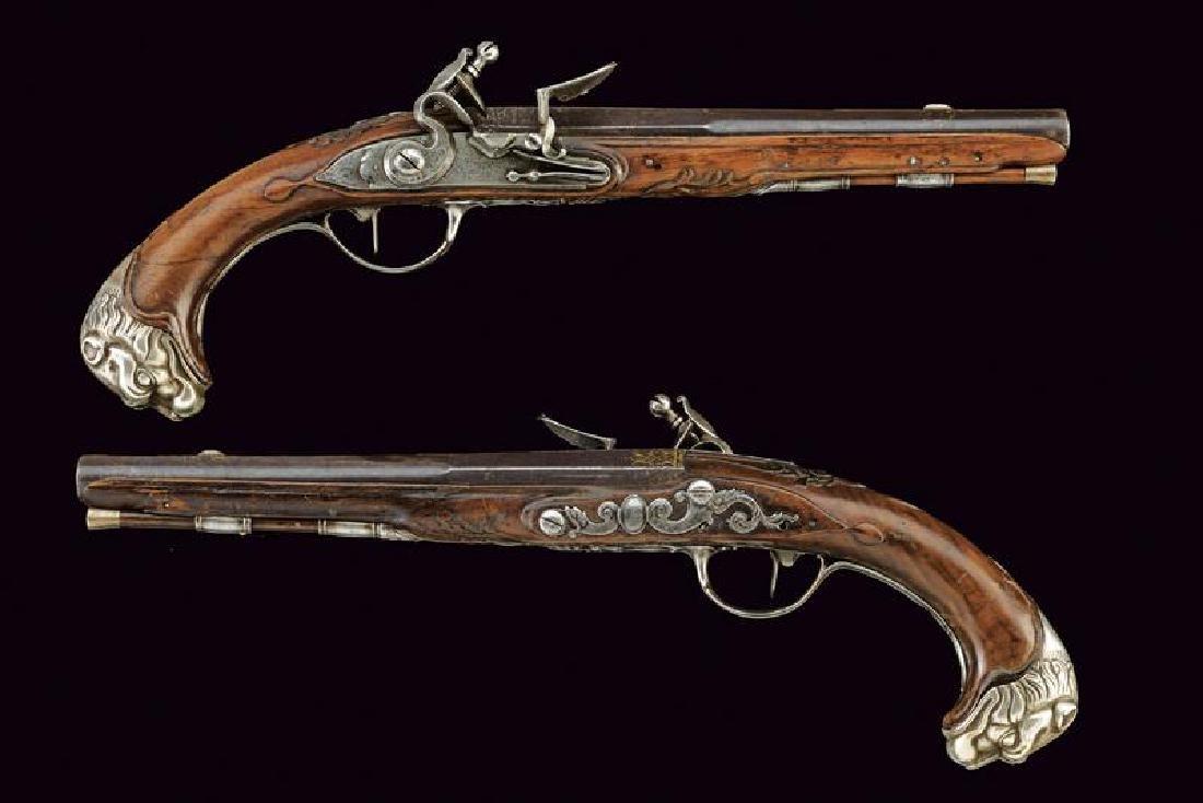A pair of flintlock pistols by Poitevin