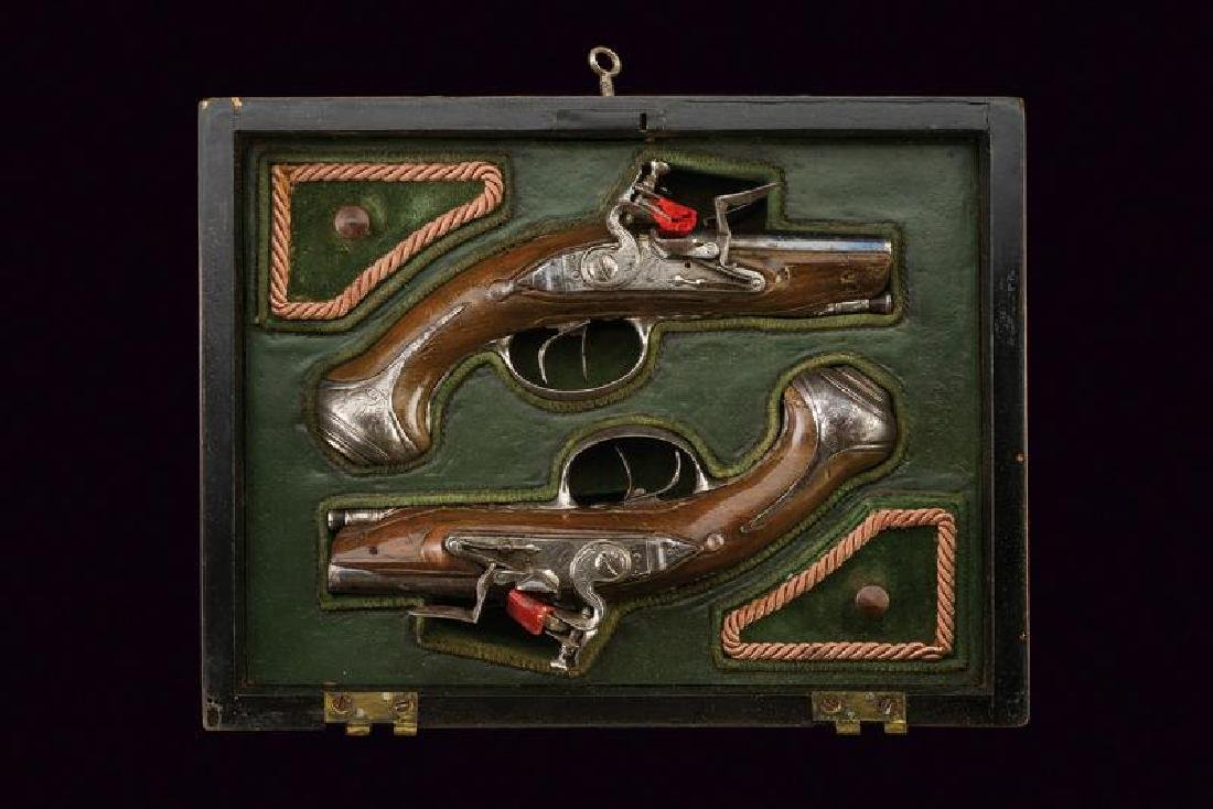 A fine cased pair of double barrelled traveling pistols