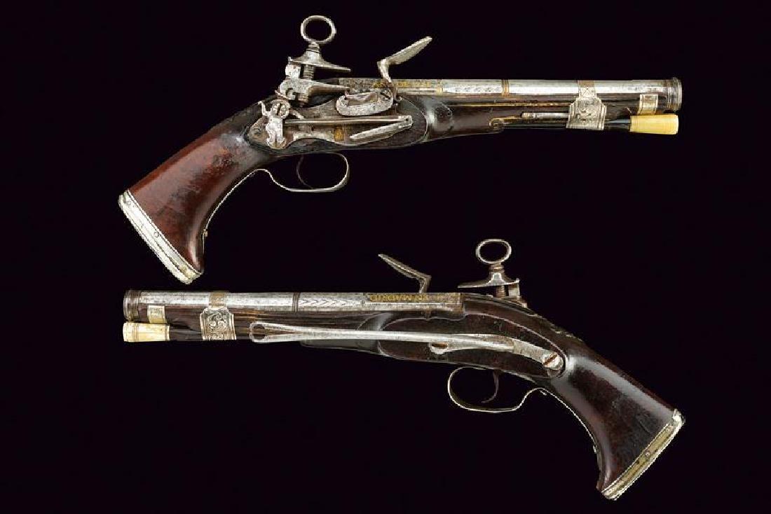 A rare pair of flintlock pistols by Nicolas Bis