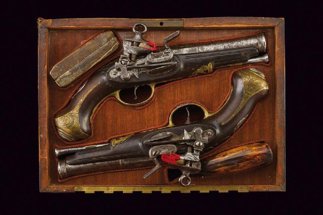 A pair of cased flintlock pistols