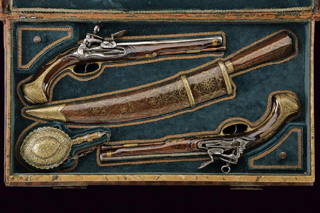 A cased pair of flintlock pistols and a knife