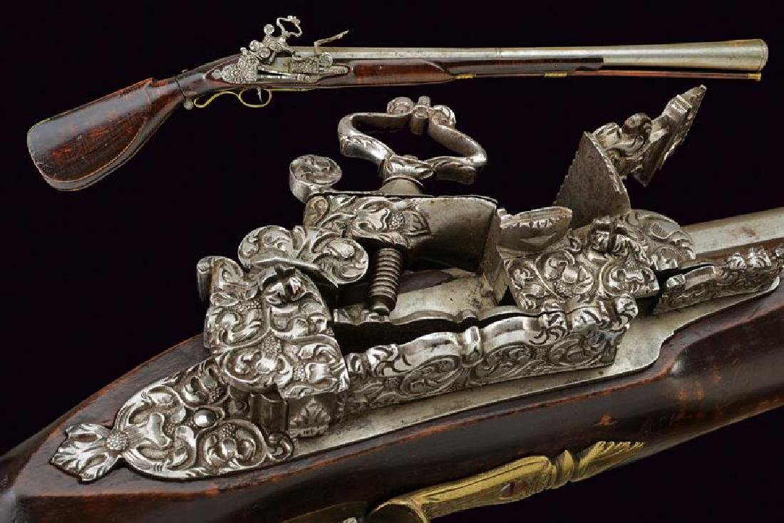 A very scarce flintlock folding blunderbuss
