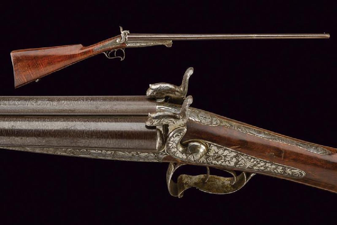 A double barreled pinfire shotgun