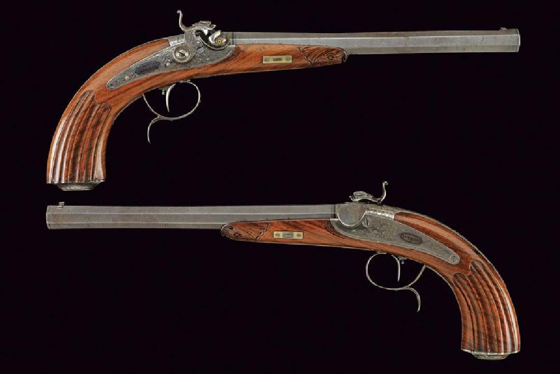 A fine pair of percussion pistols by Schreiber