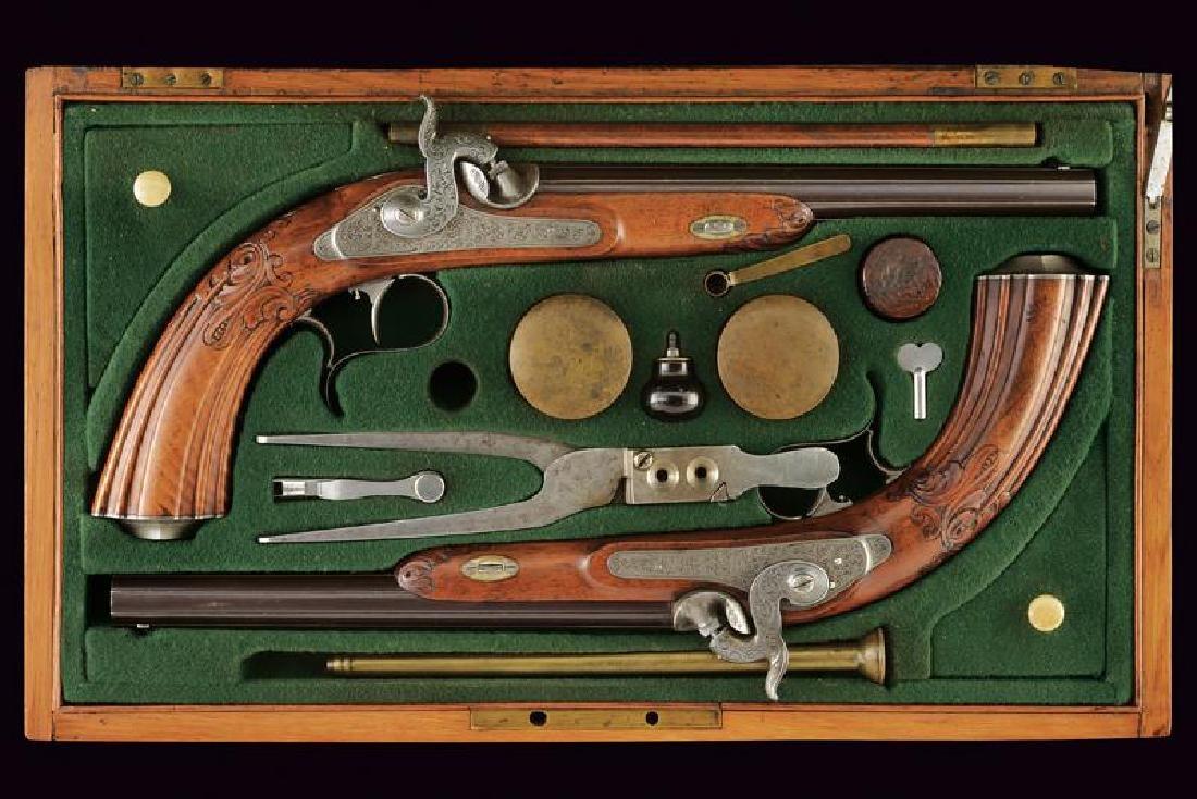 A fine pair of cased percussion pistols by Barella