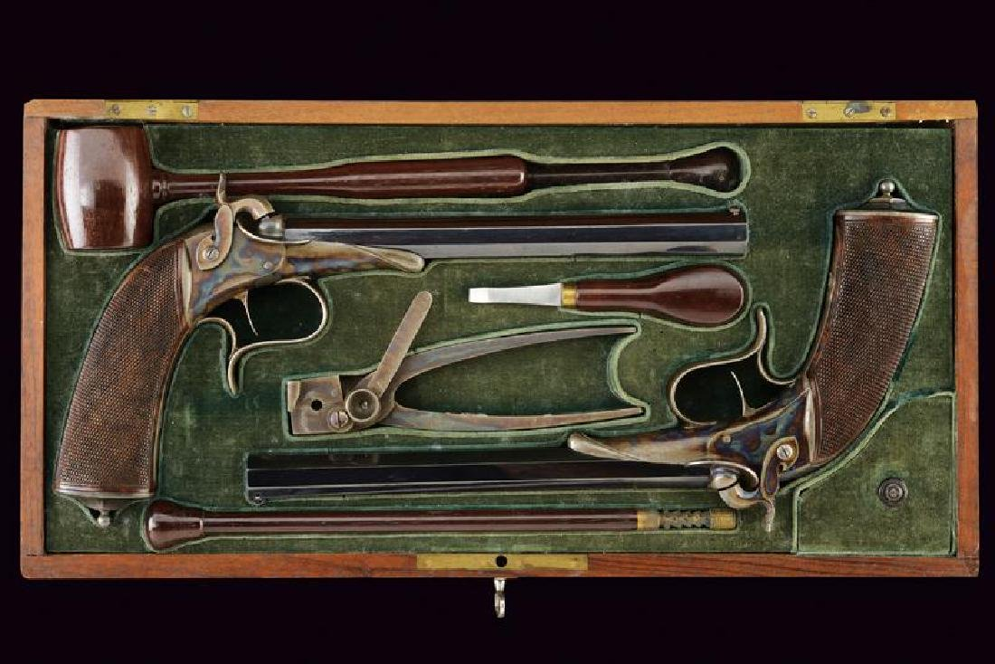 A very scarce cased pair of target pistols