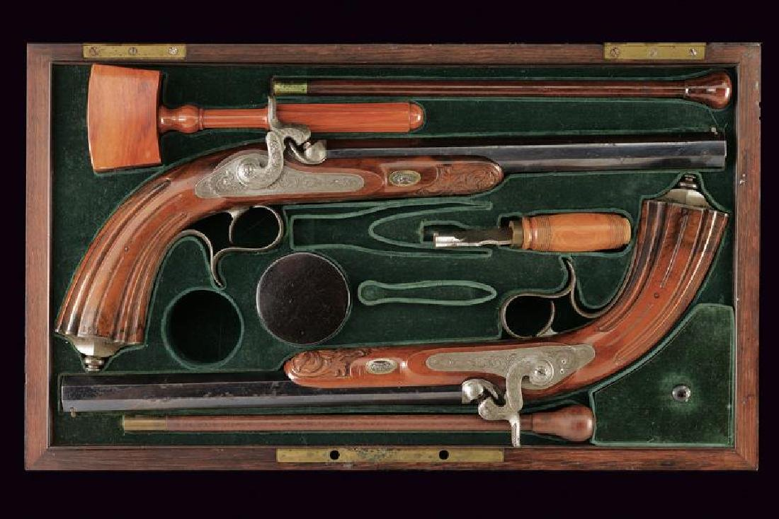 A cased pair of Devisme percussion pistols