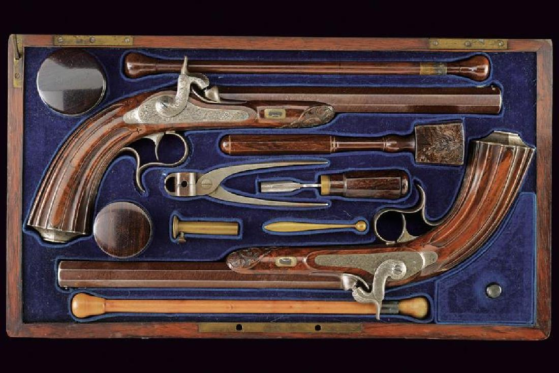 A cased pair of percussion pistols by Baucheron