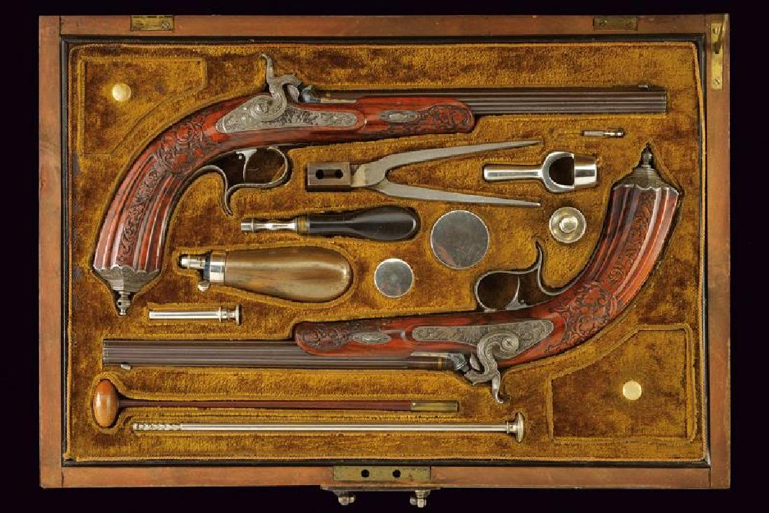 A beautiful cased pair of percussion target pistols by