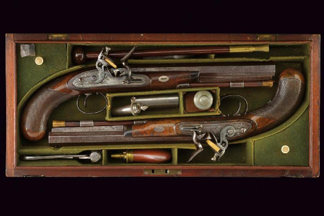 A rare cased pair of flintlock pistols by Collins