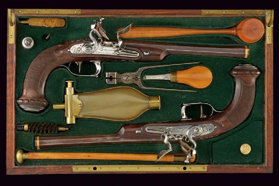 A very fine cased pair of flintlock officer's pistols