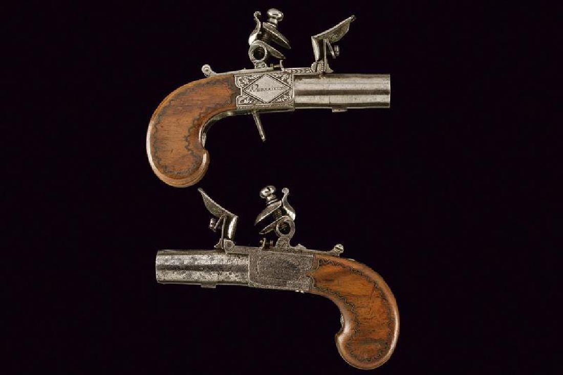 A pair of flintlock pocket pistols from the manufacture