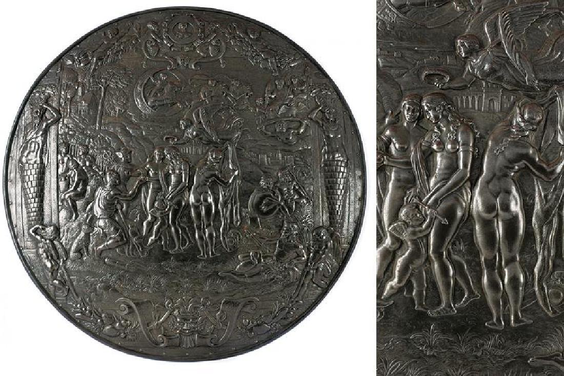 A shield with mythological scenes