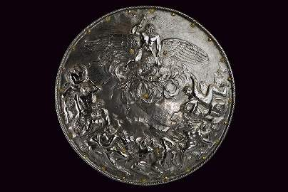 An important and beautiful embossed shield made after a