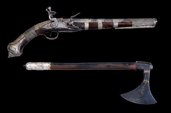 191: A flintlock pistol and a battle axe