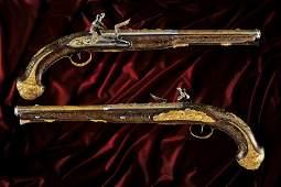 An outstanding pair of gold-mounted flintlock holster