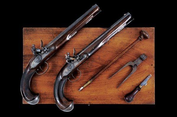 1318: A pair of cased flintlock pistols by Jacob Kucher