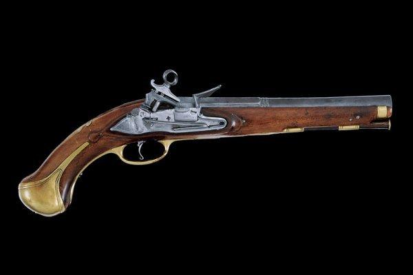 15: A navy flintlock pistol