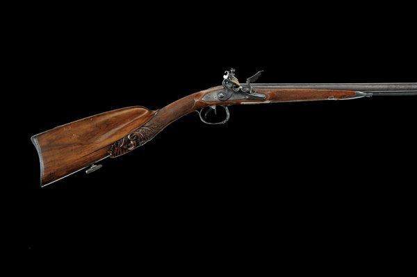 20: A double barrelled flintlock gun