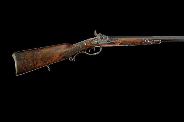 22: A double barrelled percussion gun