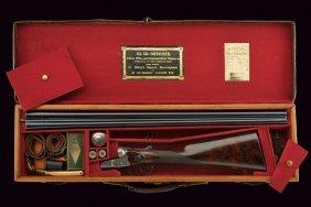 A Cased Double-barreled Shotgun By Greener