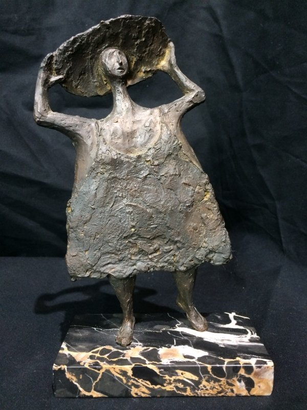 Bronze of woman with hat by Clement Renzi