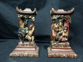 Pair of carved wood Chinese decorations