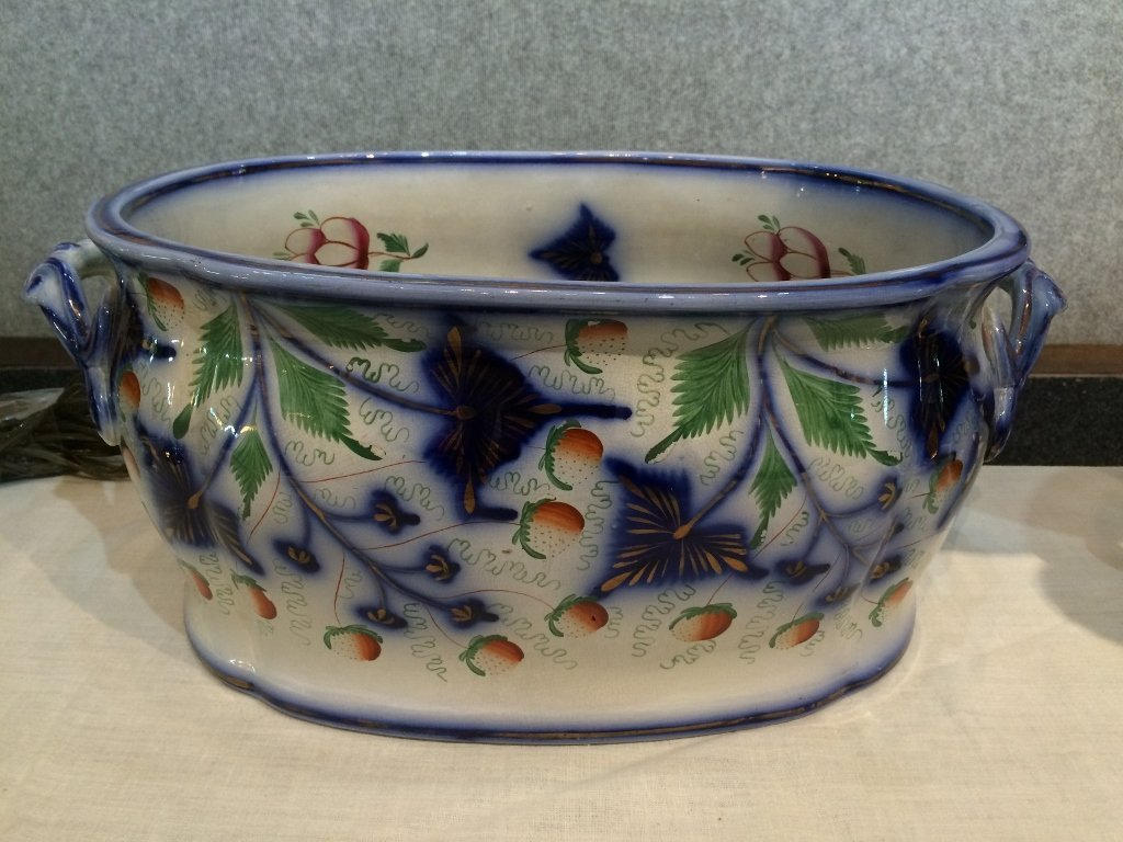 Large ceramic bowl painted with strawberries, 19th cent