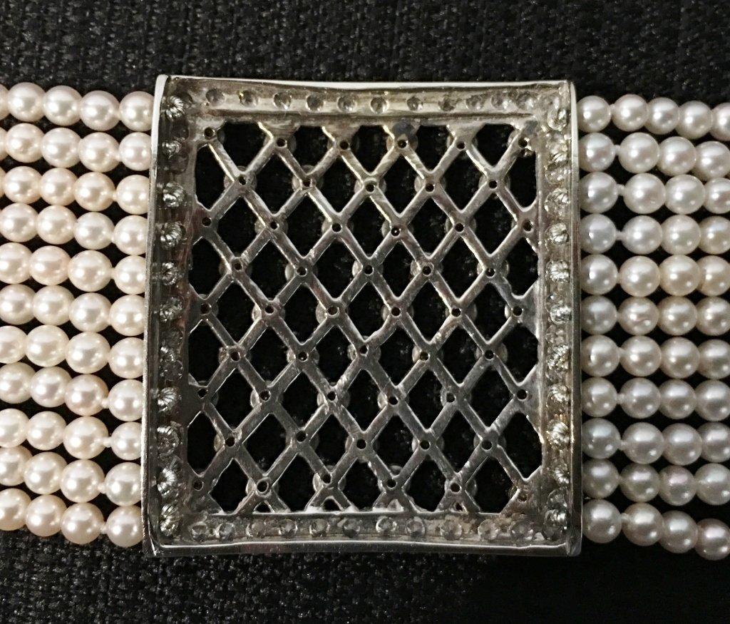 Platinum, diamond and cultured pearl choker, circa 1975 - 6