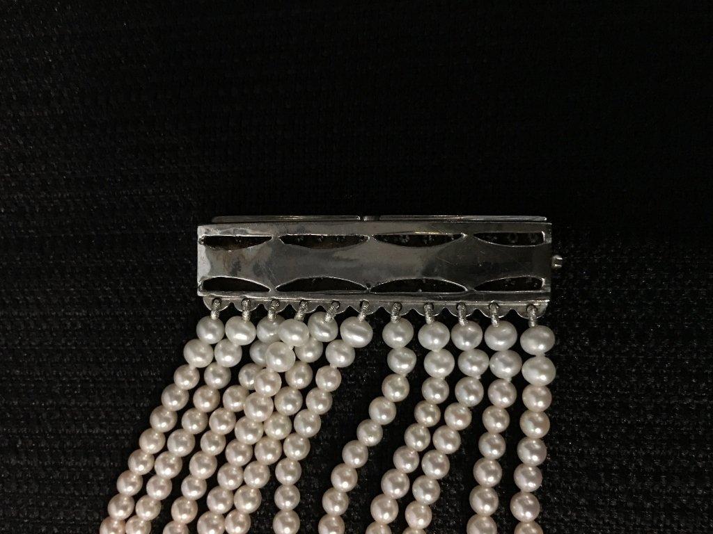 Platinum, diamond and cultured pearl choker, circa 1975 - 7