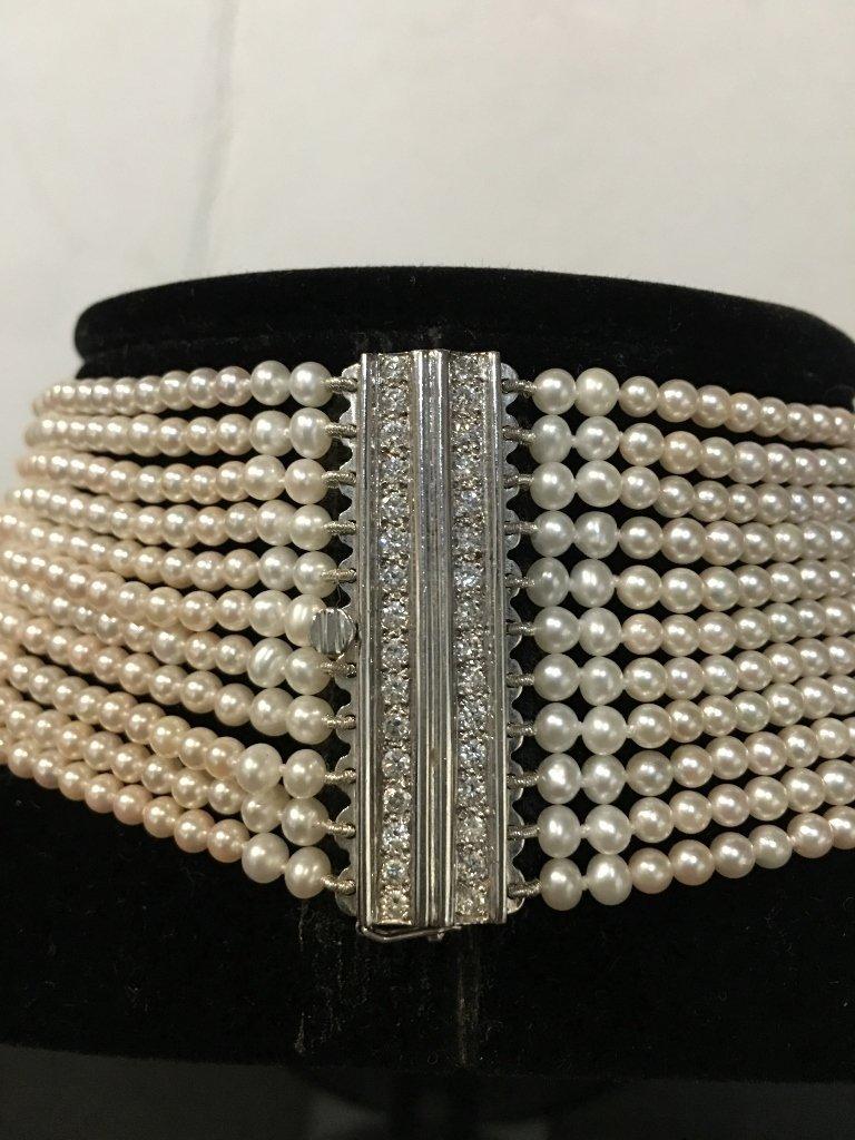Platinum, diamond and cultured pearl choker, circa 1975 - 8