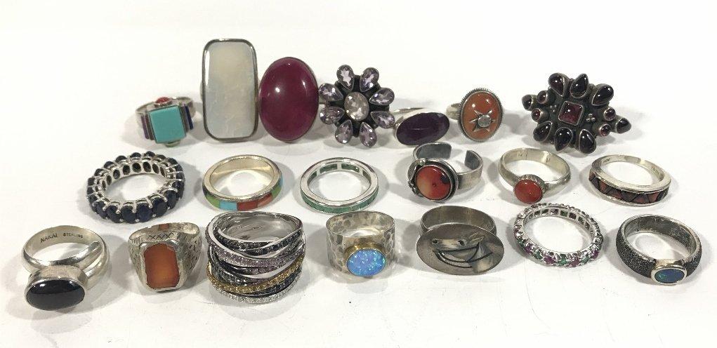 Twenty-four silver rings, 4.7 t. oz