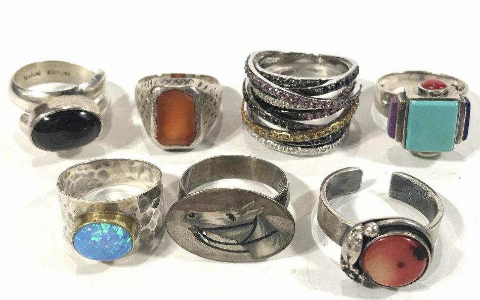 Twenty-four silver rings, 4.7 t. oz - 2