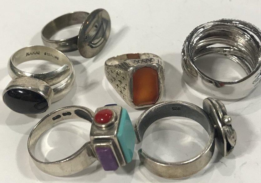 Twenty-four silver rings, 4.7 t. oz - 3