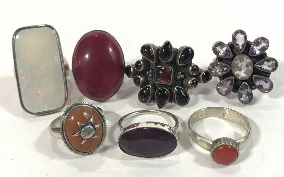 Twenty-four silver rings, 4.7 t. oz - 4