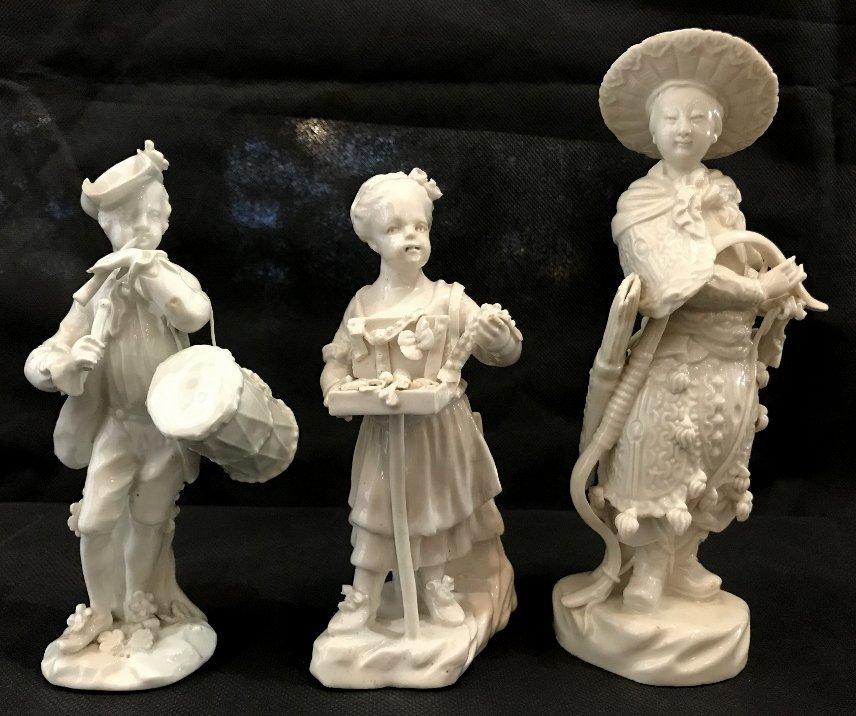 Three white porc figurines, one Meissen?