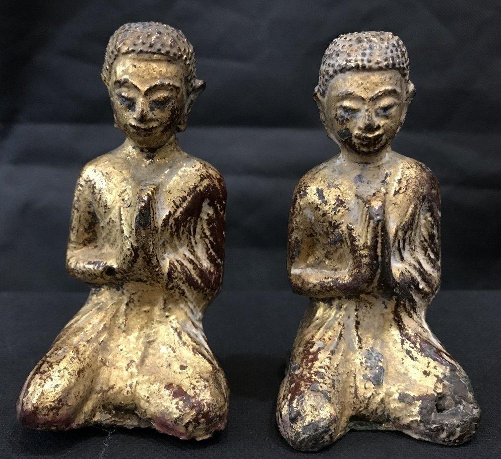 Two gilt metal praying monks, 18th/19th century