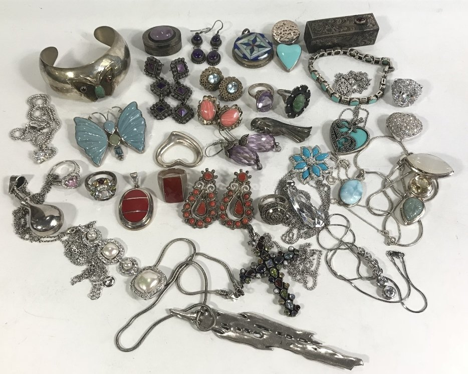 36 pieces of silver jewelry in 2 trays