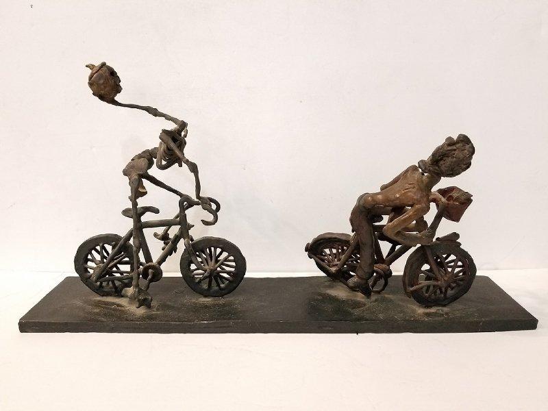 Bronze of Ichabod Crane on a bicycle, signed,1986