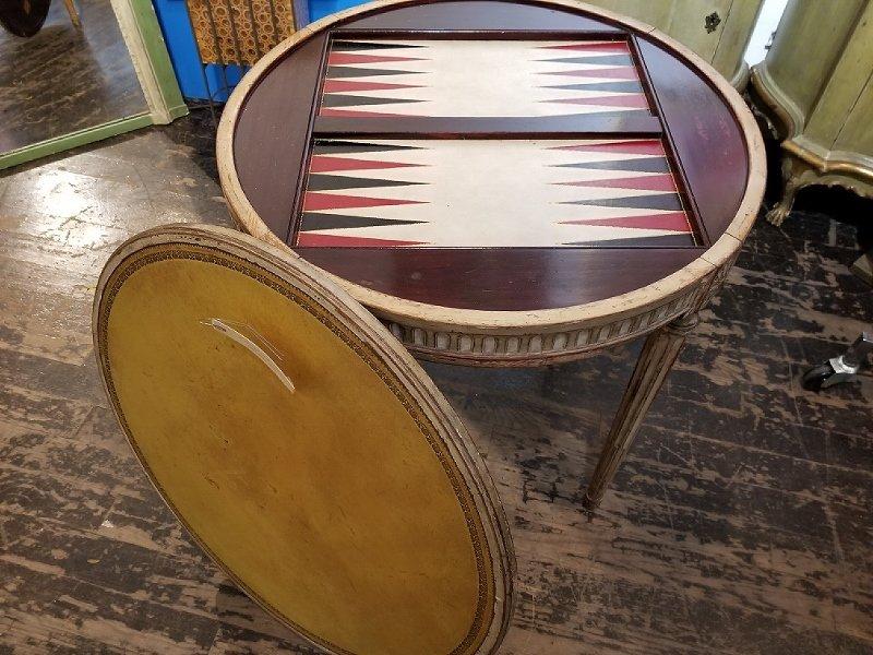 Circular wood Louis XV style game table