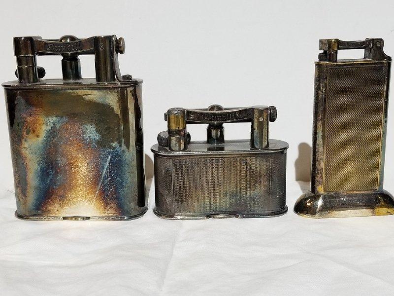 Three Dunhill lighters