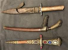 Three old daggers