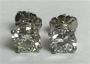Platinum and diamond stud earrings, 1.2 dwts