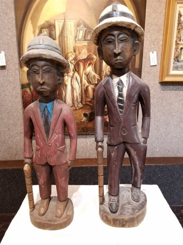 Two carved wood European men(African)