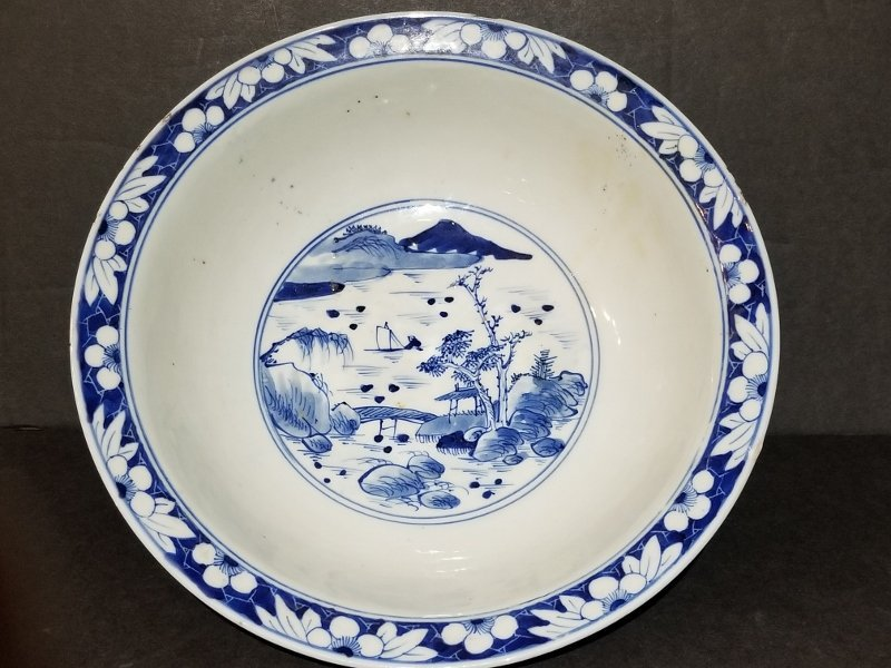 Chinese blue and white bowl with horses, c 1910