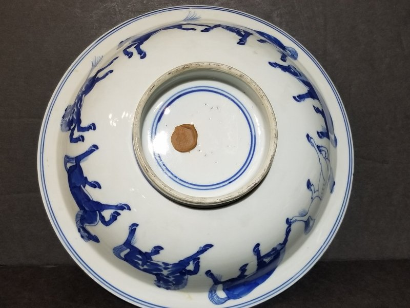 Chinese blue and white bowl with horses, c 1910 - 5