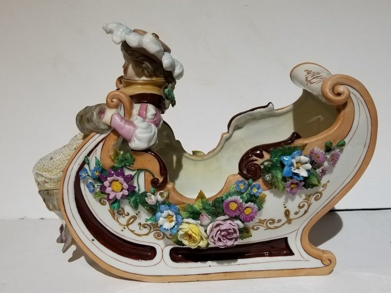 Porcelain figurine of sled, c.1880
