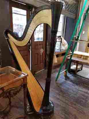 "Large black harp marked ""Salvi"""