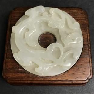 Celadon jade bi in wood holder, c.1900